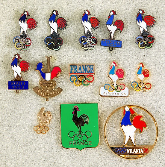 A group of 13 French Olympic Team pins dating between 1952 and 1996