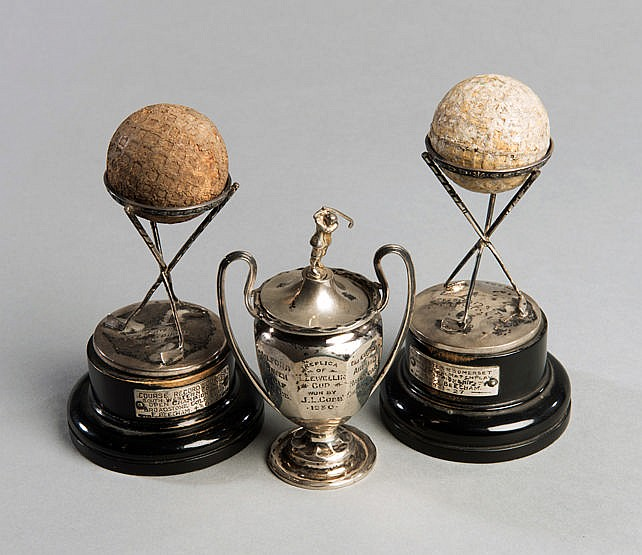 A pair of hallmarked silver Dunlop golf trophies,  with appropriate ba