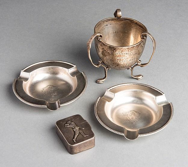 A group of silver golf collectibles, comprising a silver vesta case,