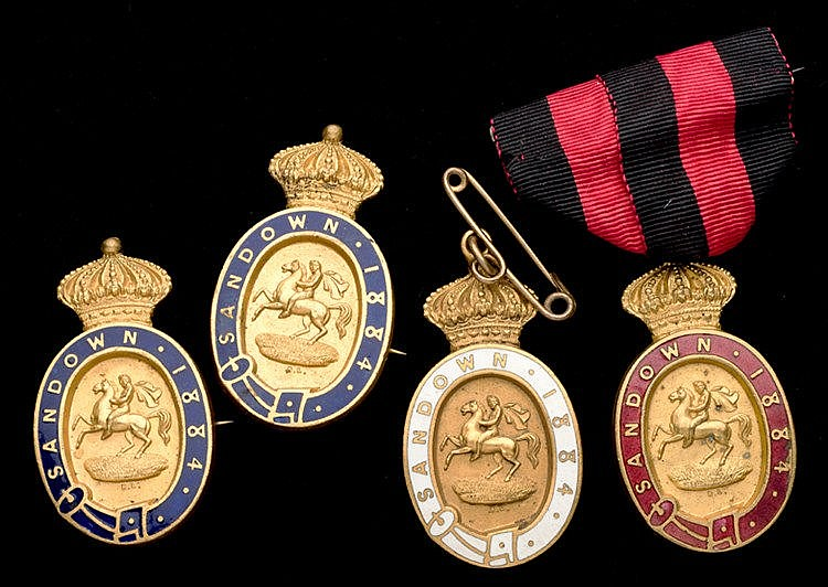 A group of four 1884 Sandown Park badges, consisting of a gentleman's