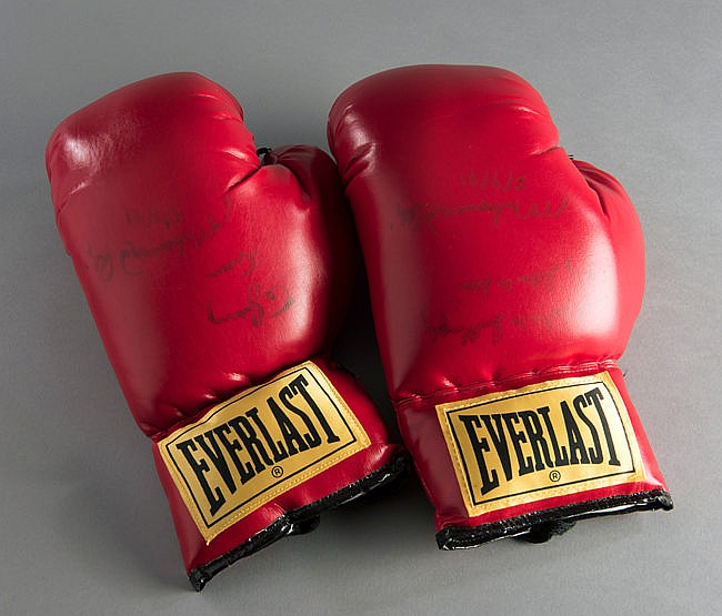 Muhammad Ali signed pair of boxing gloves,  both signed in black marke