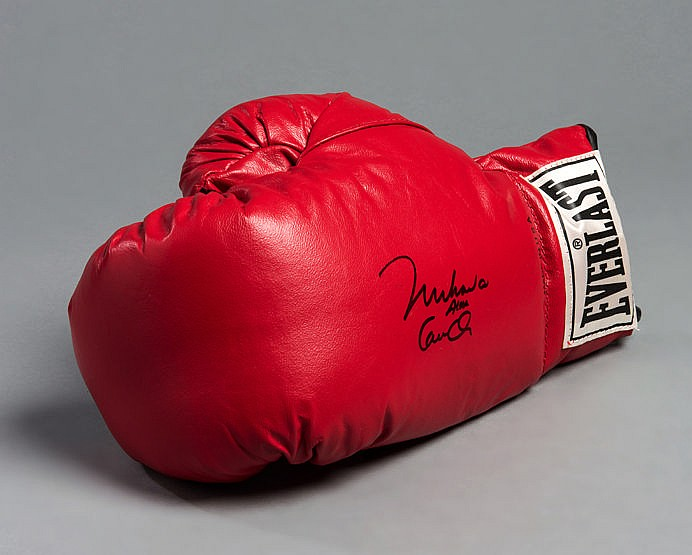A Muhammad Ali/Cassius Clay signed boxing glove,  a red left-hand glov