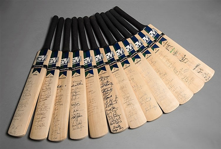 A set of 12 cricket bats fully-signed by all squad members of the 12 c