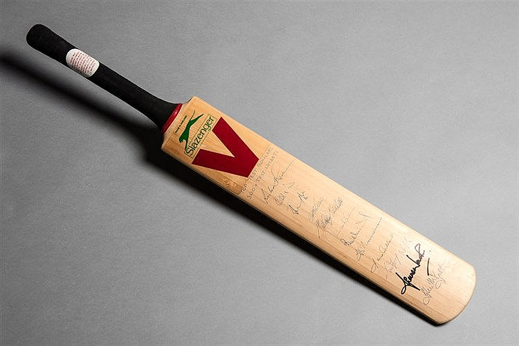 A cricket bat signed by twelve bowlers who have taken over 300 Test wi