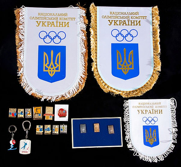 Olympic pins,  comprising: a retrospective cased set of gold, silver