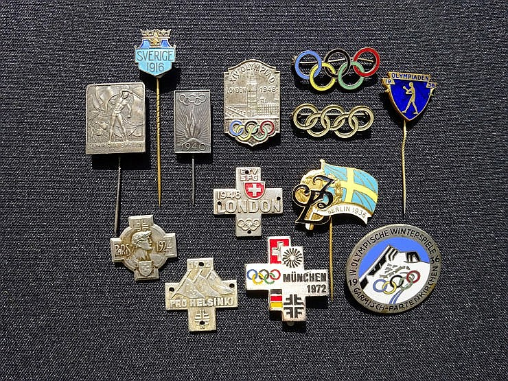 Collection of 13 Olympic pins,  including issues for Stockholm 1912, P