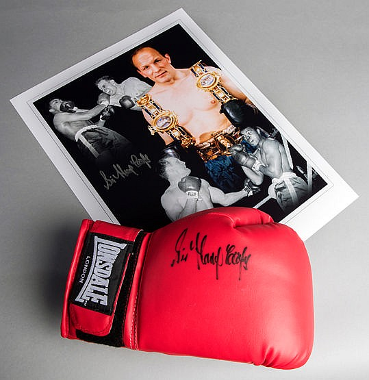 A Sir Henry Cooper signed boxing glove,  a red right-hand Lonsdale sig