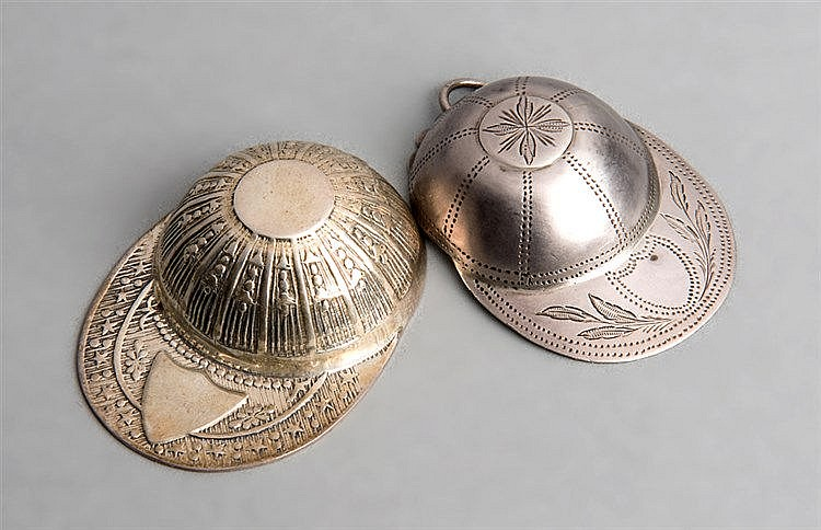 Two hallmarked silver jockey cap caddy spoons,  one with a Birmingham