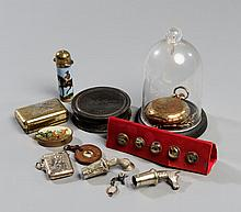 Miscellany of small racing-themed objects,  a Swiss pocket watch (with