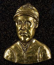 A brass relief plaque of the jockey Fred Archer,  mounted on a backboa