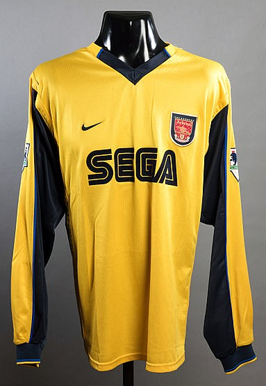 Dennis Bergkamp: a yellow Arsenal No.10 away jersey circa 2000, long-