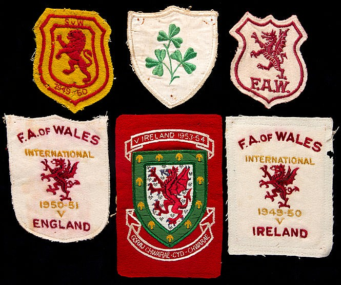 A group of six Alf Sherwood international shirt badges,  four Wales ba