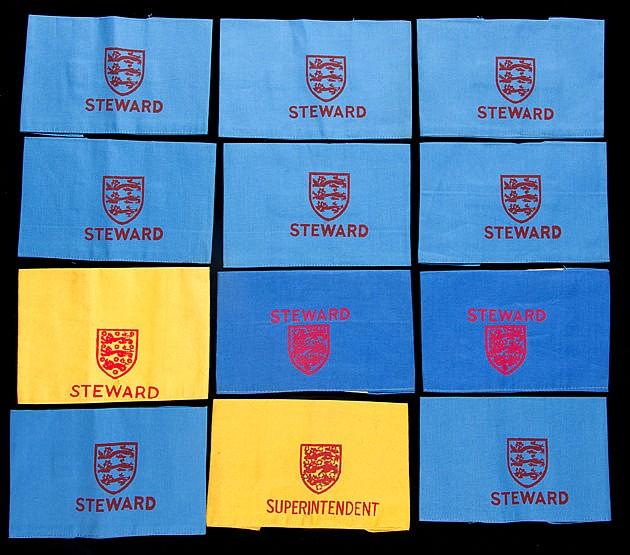Twelve Football Association Wembley Stadium steward's armbands,  in ye