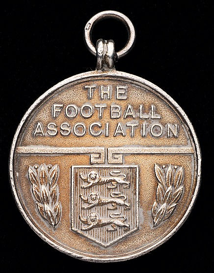 Silver medal awarded by the Football Association to Mr A.E. Moore a li