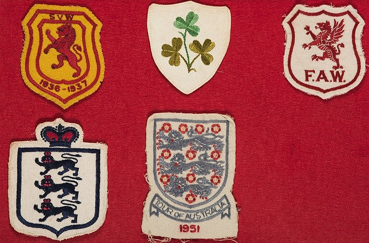 A collection of five international football shirt badges, comprising: