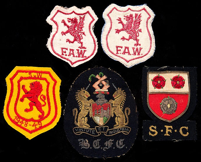 A group of five Ernie Jones football badges,  comprising two Wales int