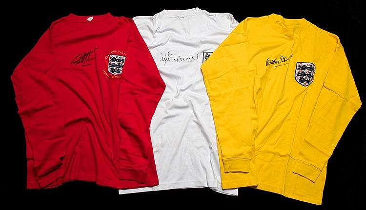 A trio of England retro jerseys signed by England 1966 World Cup squad