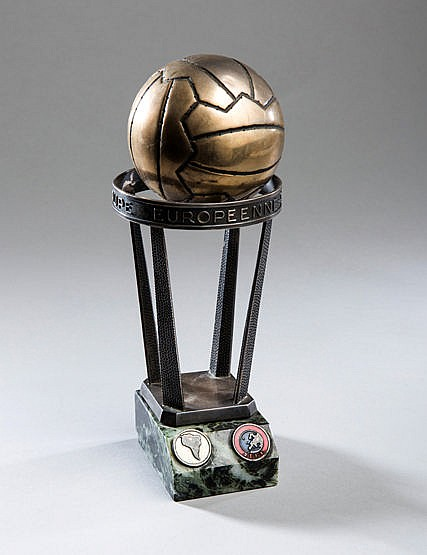 A miniature replica of the Intercontinental Cup as presented to player