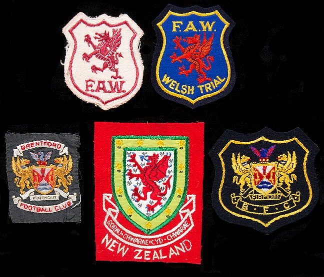Five football shirt & blazer badges, old style Wales international ba
