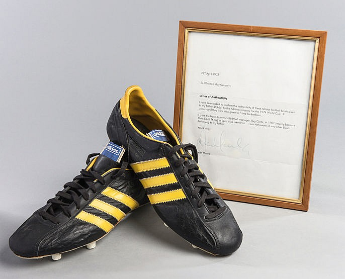 Pair of Bobby Moore football boots circa 1974,  a pair of black & yell