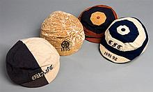 A group of four caps awarded to the famous early England amateur inter
