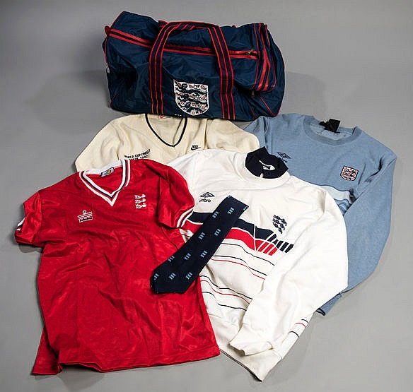 A group of England football team issued clothing, two Umbro sweaters,