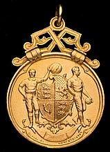 A sample F.A. Cup winner's medal,  in non-precious metal produced by t