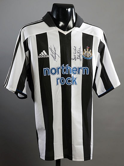 Newcastle United replica jersey signed by Sir Bobby Robson and Alan Sh