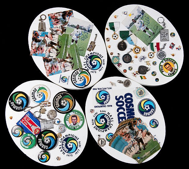 Cosmos and Pele memorabilia, comprising four oval-shaped polystyrene