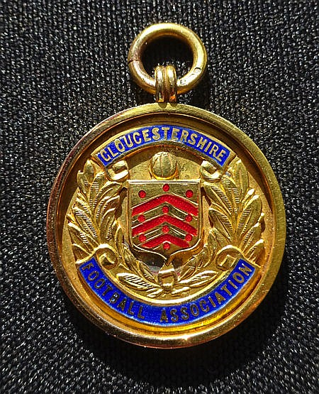 9ct. gold & enamel Gloucestershire Football Association medal 1934-35,