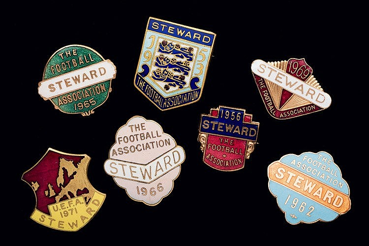 A group of seven Football Association Wembley steward's badges, in gi
