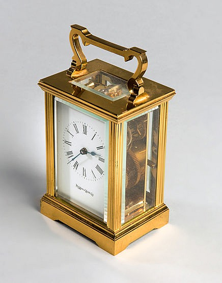 A Mappin & Webb carriage clock retirement presentation to the football