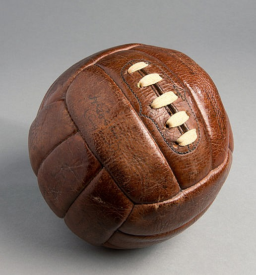 A leather football signed by the England and Wales football teams late