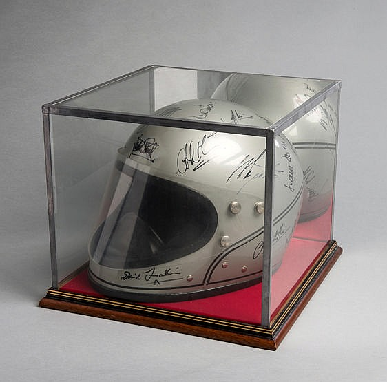A vintage silver Stadium Achilles crash helmet signed by 20 personalit