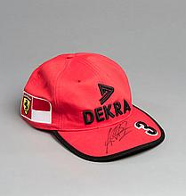 Michael Schumacher-signed 1998 Ferrari team cap,  his marker pen signa