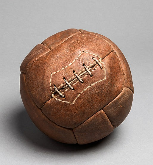 A vintage 12-panel leather football circa 1930, brown leather, good c