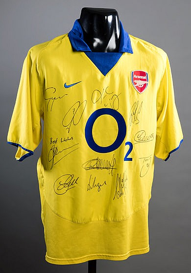 Yellow Arsenal replica jersey signed by the 2003-04 'invincibles' team