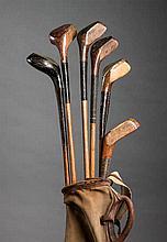 Six scared-head golf clubs