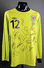 Jason Brown: a team-signed green Wales No.12 bench-worn goalkeeping jersey from the Gary Speed Memorial Match Wales v Costa Rica 29th February 2012