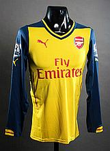 Alexis Sanchez: a yellow Arsenal No.17 match-issued Premier League away jersey season 2014-15