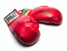 Boxing gloves signed by Muhammad Ali and Joe Frazier, two right-hand red Ev