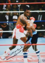 Sugar Ray Leonard signed photograph, 16 by 12in. colour, signed in black ma