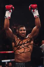 Anthony Joshua signed photograph, 12 by 8in. colour, signed in black marker