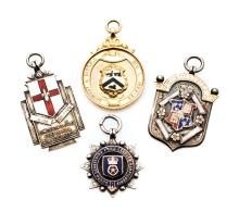 Four medals relating to football in the Midlands, i) cased gold-mounted sil