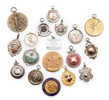 A miscellany of 18 football medals, one 9ct. gold & enamel, five gold-mount