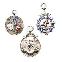 Three medals relating to football in Wales, i) silver & enamel West Wales F