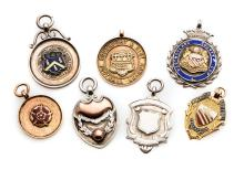 Six medals relating to football in North West England, comprising: a cased