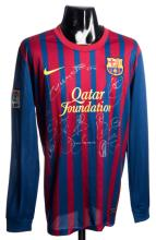 Team-signed replica of Lionel Messi's Barcelona 2011-12 No.10 home jersey,