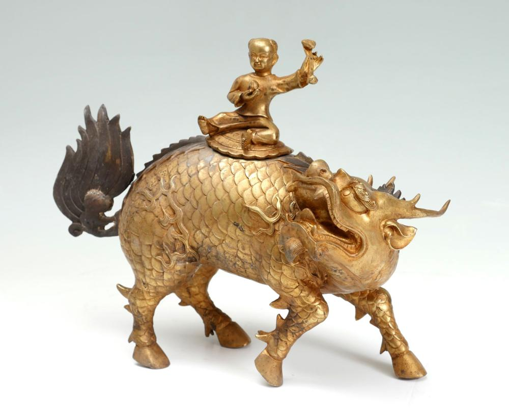 CHINESE GILT BRONZE CHI-LIN WITH YOUNG WARRIOR