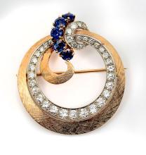 14K MID CENTURY DIAMOND AND SAPPHIRE CIRCLE RIBBON